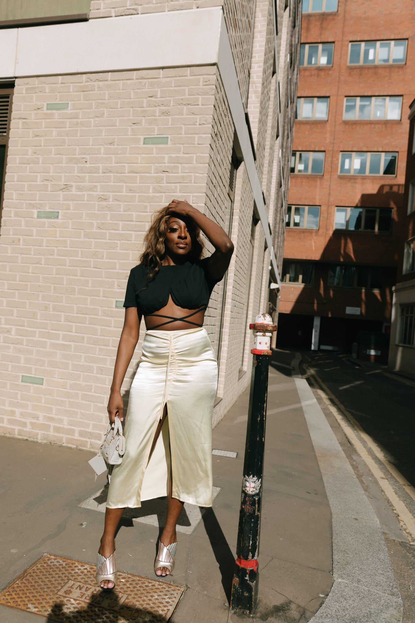 Jacquemus T-Shirt and Crop Top - Zara Satin midi skirt - Balenciaga mini city bag - Tasha Antwi